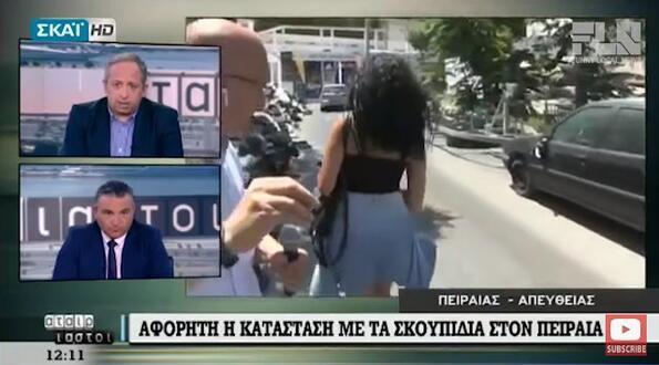 Репортер блокира, заради сексапилна жена