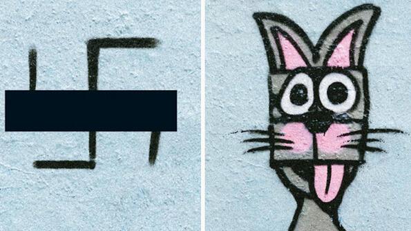 Вижте как артисти покриват свастиките по сградите в Берлин